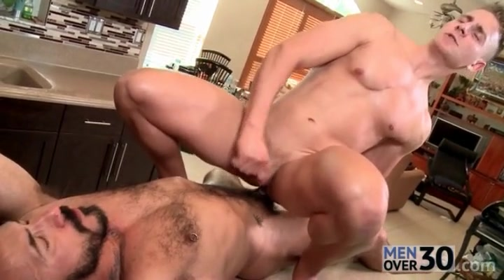 Shaved guy rides bear cock on kitchen counter